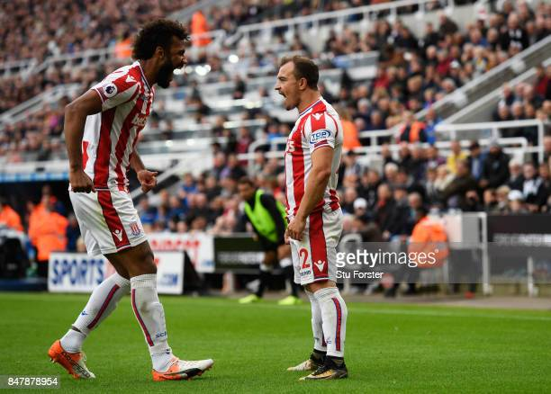 Xherdan Shaqiri of Stoke City celebrates scoring his sides first goal with Maxim ChoupoMoting of Stoke City during the Premier League match between...