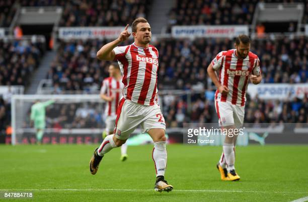 Xherdan Shaqiri of Stoke City celebrates scoring his sides first goal during the Premier League match between Newcastle United and Stoke City at St...