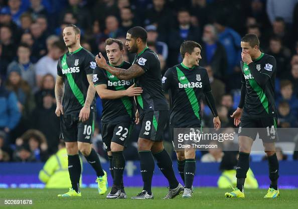 Xherdan Shaqiri of Stoke City celebrates scoring his team's second goal with his team mates during the Barclays Premier League match between Everton...