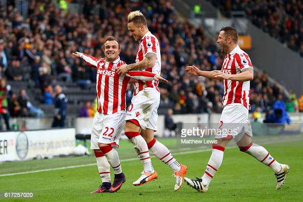 Xherdan Shaqiri of Stoke City celebrates scoring his team's second goal with his team mates Marko Arnautovic and Phillip Bardsley during the Premier...