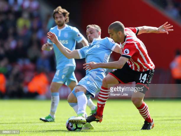 Xherdan Shaqiri of Stoke City is tackled by Oriol Romeu of Southampton during the Premier League match between Southampton and Stoke City at St...