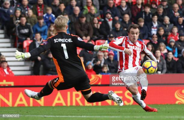 Xherdan Shaqiri of Stoke City scores his sides first goal during the Premier League match between Stoke City and Leicester City at Bet365 Stadium on...