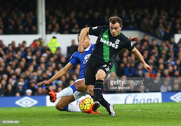Xherdan Shaqiri of Stoke City scores his team's first goal during the Barclays Premier League match between Everton and Stoke City at Goodison Park...