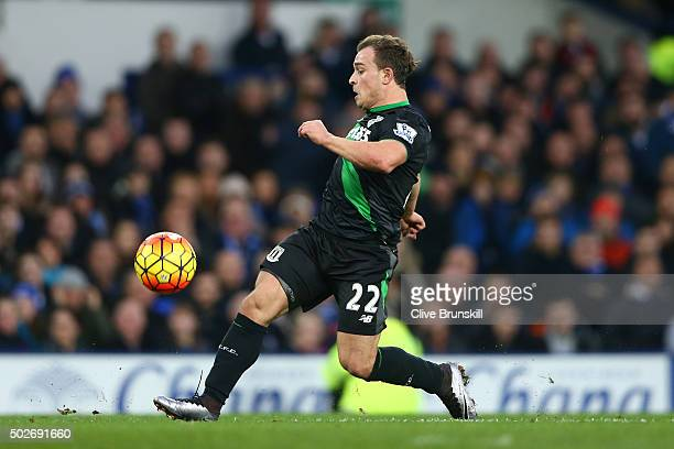 Xherdan Shaqiri of Stoke City scores his team's second goal during the Barclays Premier League match between Everton and Stoke City at Goodison Park...