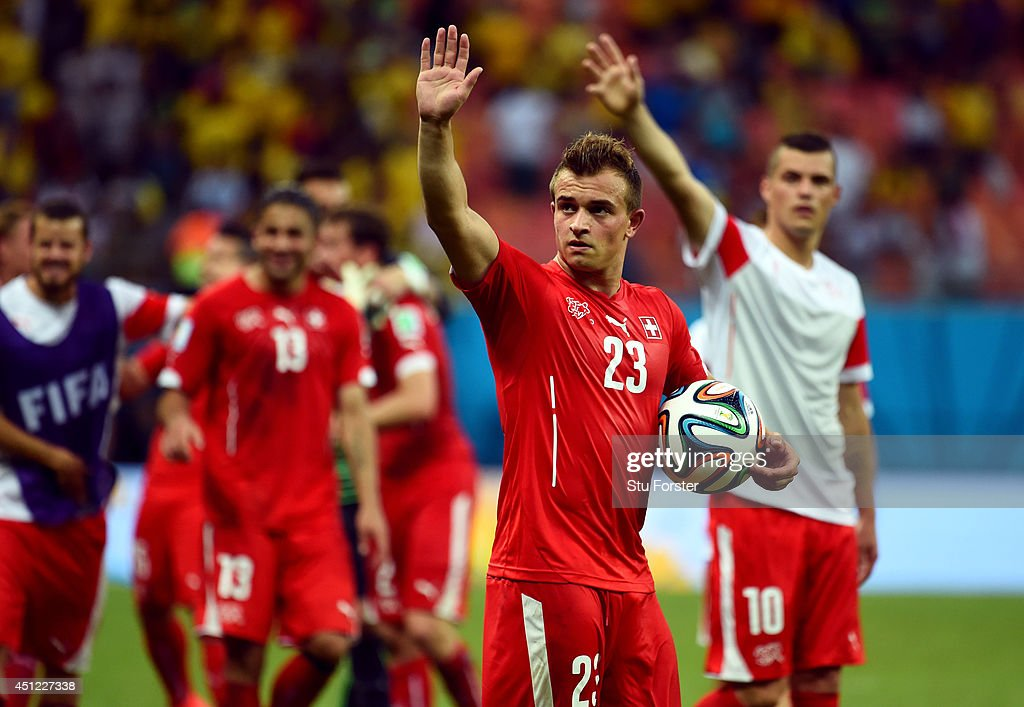 <a gi-track='captionPersonalityLinkClicked' href=/galleries/search?phrase=Xherdan+Shaqiri&family=editorial&specificpeople=6923918 ng-click='$event.stopPropagation()'>Xherdan Shaqiri</a> of Switzerland acknowledges the fans after a 3-0 victory over Honduras in the 2014 FIFA World Cup Brazil Group E match between Honduras and Switzerland at Arena Amazonia on June 25, 2014 in Manaus, Brazil.