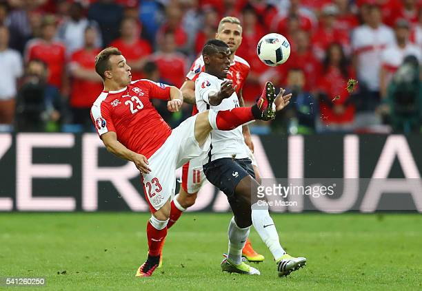 Xherdan Shaqiri of Switzerland and Paul Pogba of France compete for the ball during the UEFA EURO 2016 Group A match between Switzerland and France...