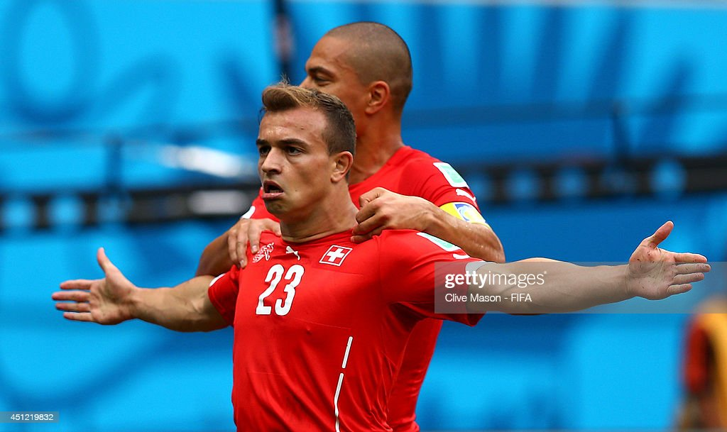 <a gi-track='captionPersonalityLinkClicked' href=/galleries/search?phrase=Xherdan+Shaqiri&family=editorial&specificpeople=6923918 ng-click='$event.stopPropagation()'>Xherdan Shaqiri</a> (R) of Switzerland celebrates scoring his team's first goal with his teammate Gokhan Inler of Switzerland during the 2014 FIFA World Cup Brazil Group E match between Honduras and Switzerland at Arena Amazonia on June 25, 2014 in Manaus, Brazil.