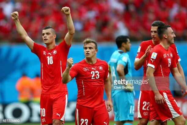 Xherdan Shaqiri of Switzerland celebrates scoring his team's third goal and completes his hat trick during the 2014 FIFA World Cup Brazil Group E...
