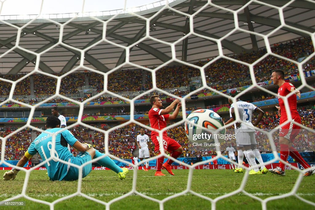 <a gi-track='captionPersonalityLinkClicked' href=/galleries/search?phrase=Xherdan+Shaqiri&family=editorial&specificpeople=6923918 ng-click='$event.stopPropagation()'>Xherdan Shaqiri</a> of Switzerland celebrates scoring his team's third goal past goalkeeper Noel Valladares of Honduras and completes his hat trick during the 2014 FIFA World Cup Brazil Group E match between Honduras and Switzerland at Arena Amazonia on June 25, 2014 in Manaus, Brazil.