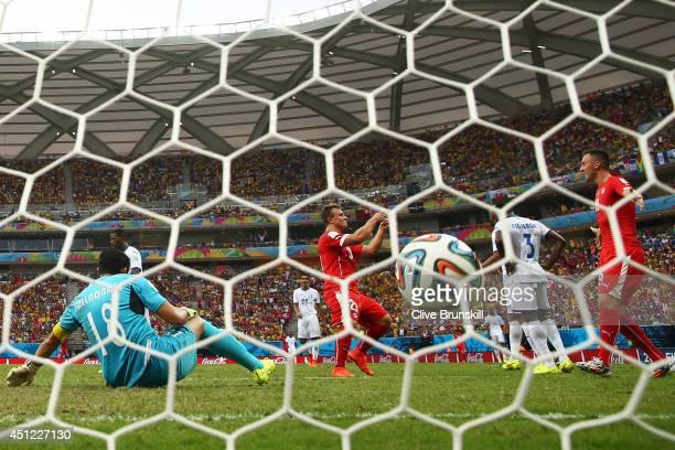 Xherdan Shaqiri of Switzerland celebrates scoring his team's third goal past goalkeeper Noel Valladares of Honduras and completes his hat trick...