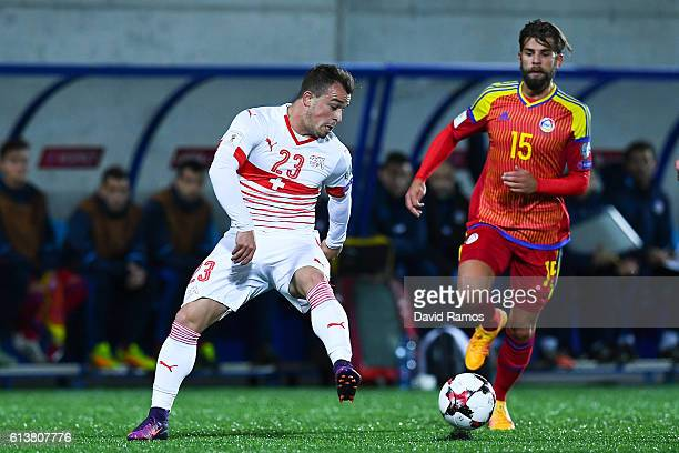 Xherdan Shaqiri of Switzerland competes for the ball with Moises San Nicolas of Andorra during the FIFA 2018 World Cup Qualifier between Andorra and...