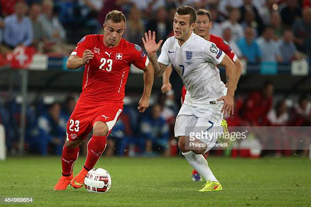 Xherdan Shaqiri of Switzerland fights for the ball with Jack Wilshere of England during the EURO 2016 Qualifier match between Switzerland and England...