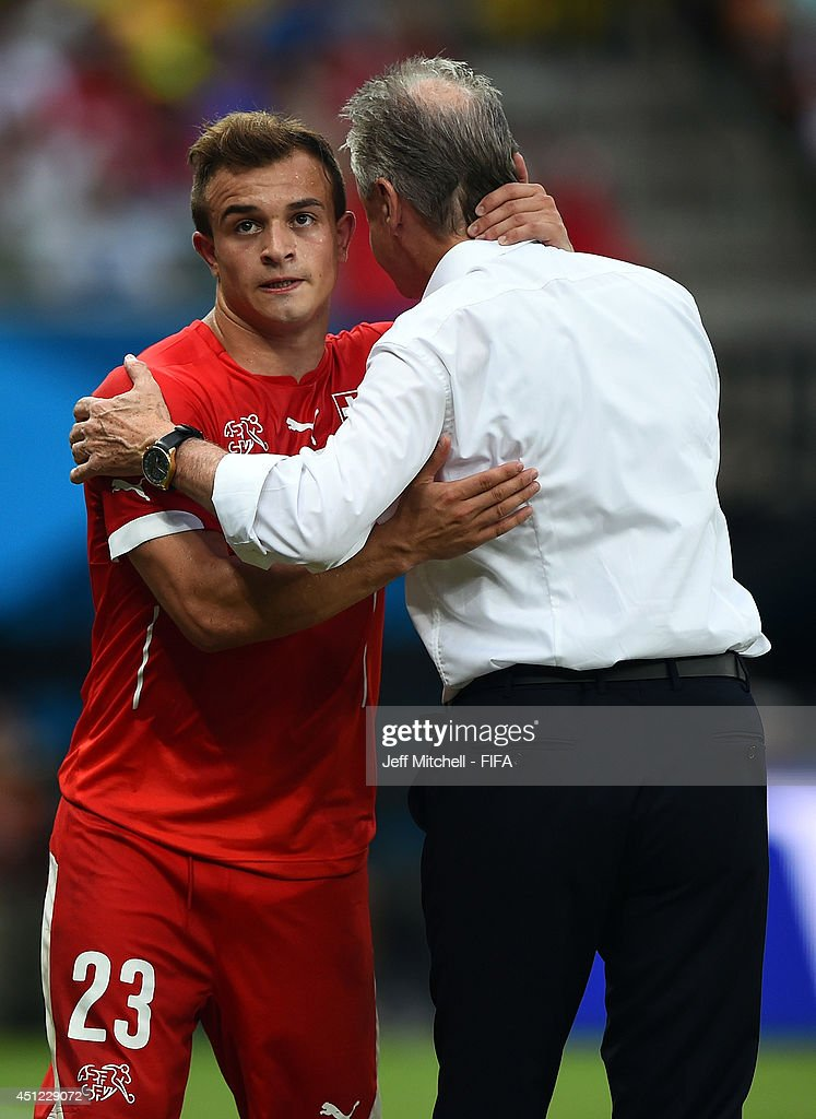 <a gi-track='captionPersonalityLinkClicked' href=/galleries/search?phrase=Xherdan+Shaqiri&family=editorial&specificpeople=6923918 ng-click='$event.stopPropagation()'>Xherdan Shaqiri</a> (L) of Switzerland is congratulated by head coach <a gi-track='captionPersonalityLinkClicked' href=/galleries/search?phrase=Ottmar+Hitzfeld&family=editorial&specificpeople=624332 ng-click='$event.stopPropagation()'>Ottmar Hitzfeld</a> as he is replaced during the 2014 FIFA World Cup Brazil Group E match between Honduras and Switzerland at Arena Amazonia on June 25, 2014 in Manaus, Brazil.