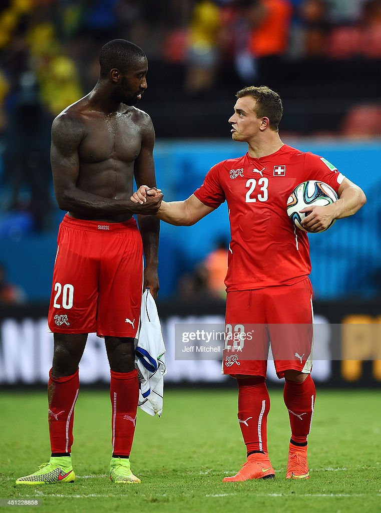<a gi-track='captionPersonalityLinkClicked' href=/galleries/search?phrase=Xherdan+Shaqiri&family=editorial&specificpeople=6923918 ng-click='$event.stopPropagation()'>Xherdan Shaqiri</a> of Switzerland is congratulated by <a gi-track='captionPersonalityLinkClicked' href=/galleries/search?phrase=Johan+Djourou&family=editorial&specificpeople=534997 ng-click='$event.stopPropagation()'>Johan Djourou</a> (L) of Switzerland after his hat trick during the 2014 FIFA World Cup Brazil Group E match between Honduras and Switzerland at Arena Amazonia on June 25, 2014 in Manaus, Brazil.