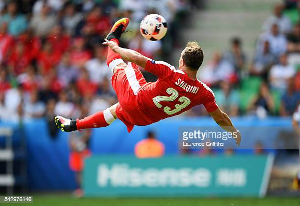 Xherdan Shaqiri of Switzerland scores his team's first goal during the UEFA EURO 2016 round of 16 match between Switzerland and Poland at Stade...