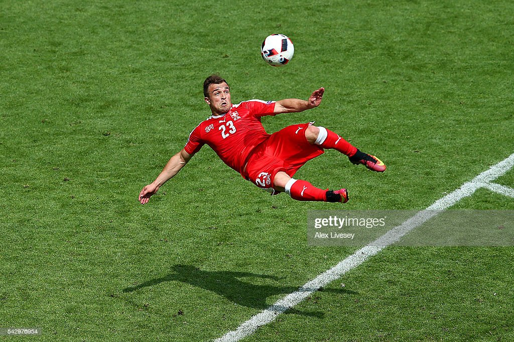<a gi-track='captionPersonalityLinkClicked' href=/galleries/search?phrase=Xherdan+Shaqiri&family=editorial&specificpeople=6923918 ng-click='$event.stopPropagation()'>Xherdan Shaqiri</a> of Switzerland scores his team's first goal during the UEFA EURO 2016 round of 16 match between Switzerland and Poland at Stade Geoffroy-Guichard on June 25, 2016 in Saint-Etienne, France.