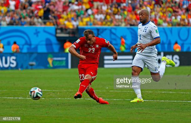 Xherdan Shaqiri of Switzerland shoots and scores his team's second goal during the 2014 FIFA World Cup Brazil Group E match between Honduras and...