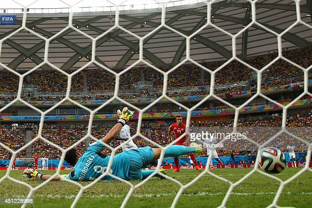 Xherdan Shaqiri of Switzerland shoots and scores his team's third goal past goalkeeper Noel Valladares of Honduras and completes his hat trick during...