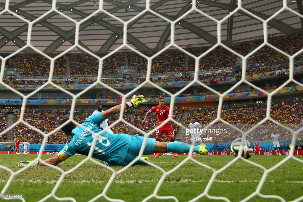 <a gi-track='captionPersonalityLinkClicked' href=/galleries/search?phrase=Xherdan+Shaqiri&family=editorial&specificpeople=6923918 ng-click='$event.stopPropagation()'>Xherdan Shaqiri</a> of Switzerland shoots and scores his team's third goal past goalkeeper <a gi-track='captionPersonalityLinkClicked' href=/galleries/search?phrase=Noel+Valladares&family=editorial&specificpeople=2587219 ng-click='$event.stopPropagation()'>Noel Valladares</a> of Honduras and completes his hat trick during the 2014 FIFA World Cup Brazil Group E match between Honduras and Switzerland at Arena Amazonia on June 25, 2014 in Manaus, Brazil.