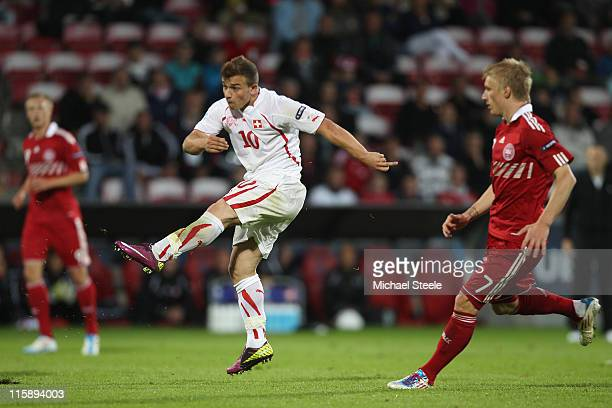 Xherdan Shaqiri of Switzerland shoots during the UEFA European Under21 Championship Group A match between Denmark and Switzerland at the Aalborg...
