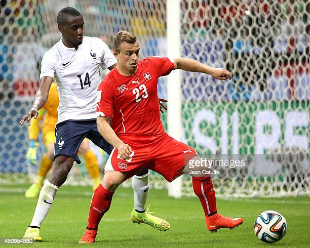 Xherdan Shaqiri of Switzerland under pressure of Blaise Matuidi of France during the 2014 FIFA World Cup Brazil Group E match between Switzerland and...