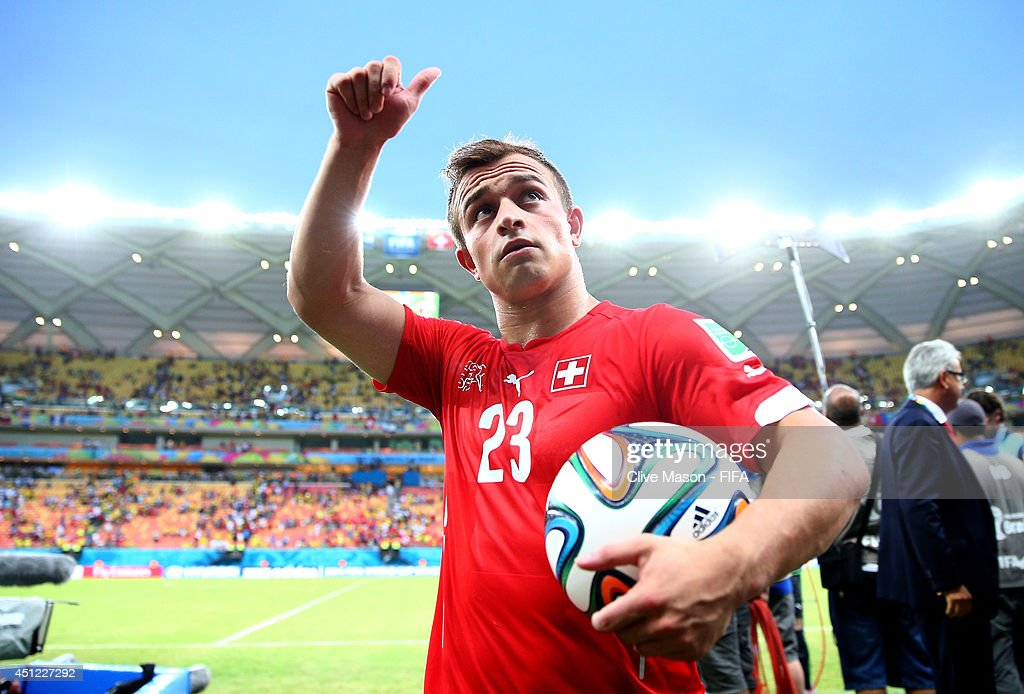 <a gi-track='captionPersonalityLinkClicked' href=/galleries/search?phrase=Xherdan+Shaqiri&family=editorial&specificpeople=6923918 ng-click='$event.stopPropagation()'>Xherdan Shaqiri</a> of Switzerland walks off the pitch with the match ball as he completed a hat trick after the 3-0 win in the 2014 FIFA World Cup Brazil Group E match between Honduras and Switzerland at Arena Amazonia on June 25, 2014 in Manaus, Brazil.
