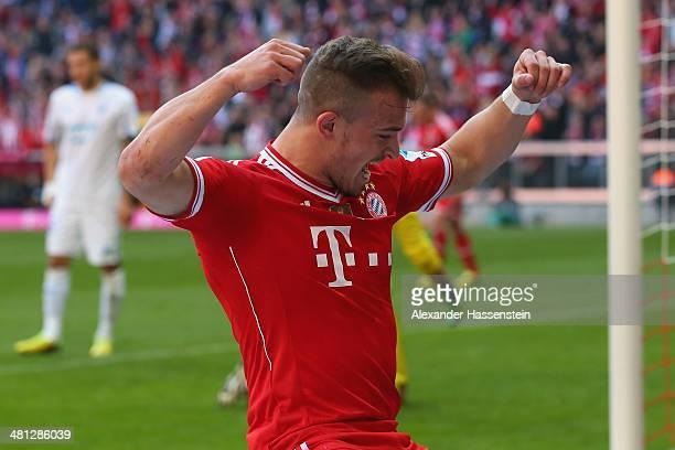 Xherdan Shaquiri of Muenchen celebrates scoring the second team goal during the Bundesliga match between FC Bayern Muenchen and 1899 Hoffenheim at...