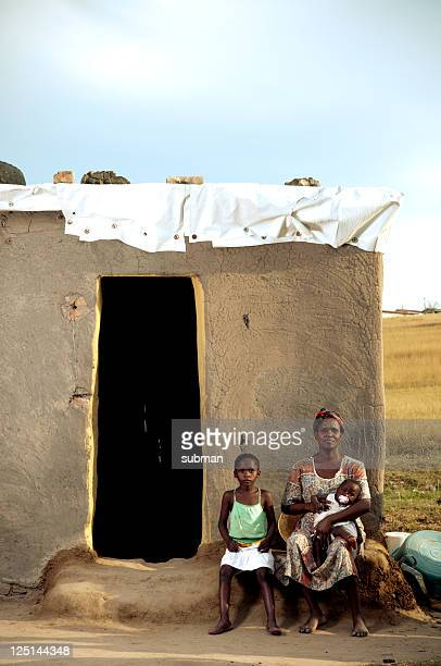 Xhosa family in front of house