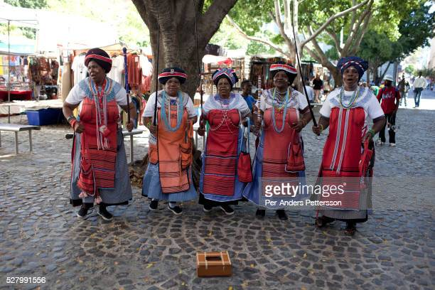 Xhosa ladies perform a traditional dance and song at Greenmarket Square market area on March 21 2012 in Cape Town South Africa