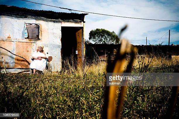 Xhosa woman infront of shelter