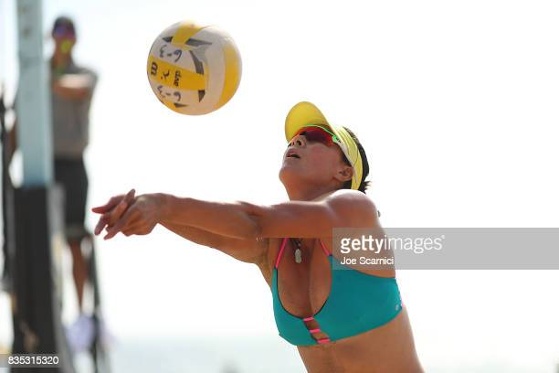 Xi 'CC' Zhang sets the ball during her round 3 match at the AVP Manhattan Beach Open Day 2 on August 18 2017 in Manhattan Beach California