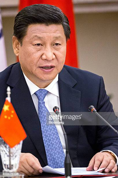 Xi Jinping China's president attends a meeting with Narendra Modi India's prime minister unseen to sign a series of agreements between the two...