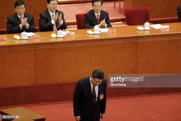 Xi Jinping China's president bows after delivering his speech at the opening of the 19th National Congress of the Communist Party of China at the...