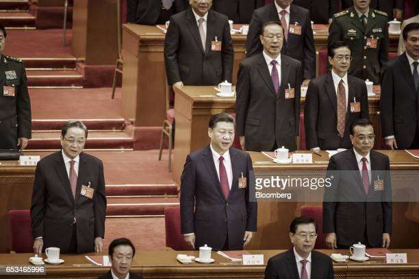 Xi Jinping China's president center Li Keqiang China's premier center right and Yu Zhengsheng chairman of the Chinese People's Political Consultative...