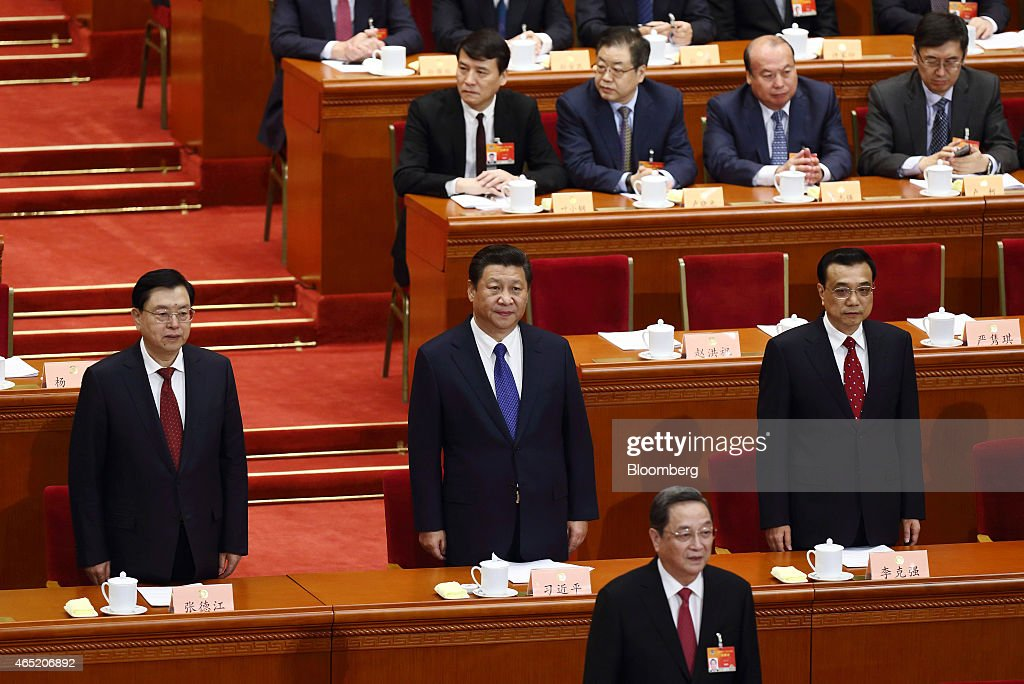 Xi Jinping, China's president, center, Li Keqiang, China's premier, right, Zhang Dejiang, chairman of the Standing Committee of the National People's Congress, left, and Yu Zhengsheng, a member of China's Politburo Standing Committee, bottom, attend the opening of the Chinese People's Political Consultative Conference (CPPCC) at the Great Hall of the People in Beijing, China, on Tuesday, March 3, 2015. China's annual meeting of the National People's Congress, which begins March 5 in Beijing, is expected to set government policies for the year on issues ranging from economic growth to military spending and pollution. Photographer: Tomohiro Ohsumi/Bloomberg via Getty Images