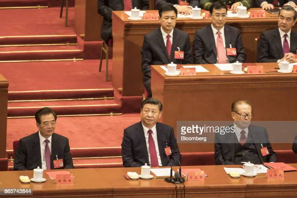 Xi Jinping China's president center sits with Jiang Zemin China's former president right and Hu Jintao China's former president left during the...
