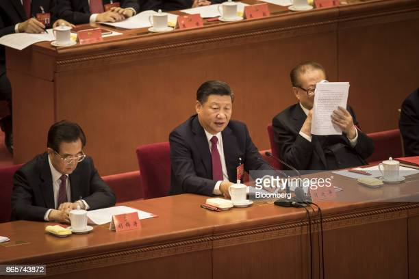 Xi Jinping China's president center speaks as Jiang Zemin China's former president right reads a document while Hu Jintao China's former president...