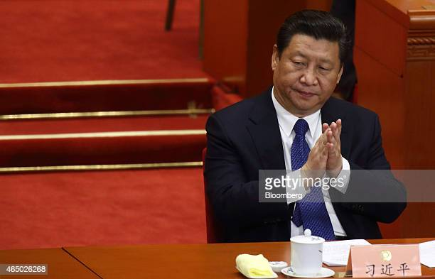 Xi Jinping China's president claps during the opening of the Chinese People's Political Consultative Conference at the Great Hall of the People in...