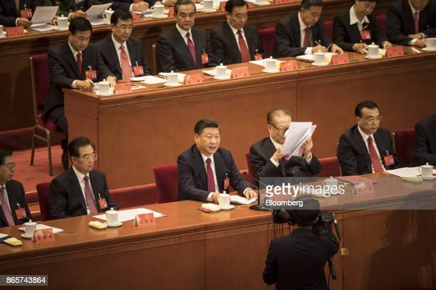 Xi Jinping China's president front row center speaks as Jiang Zemin China's former president front row second right reads a document while Li Keqiang...