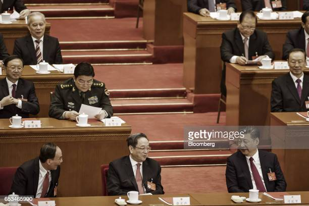 Xi Jinping China's president front row right to left speaks to Yu Zhengsheng chairman of the Chinese People's Political Consultative Conference and...