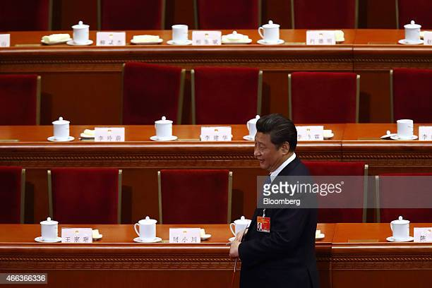 Xi Jinping China's president leaves after the closing session of the third session of the 12th National People's Congress at the Great Hall of the...