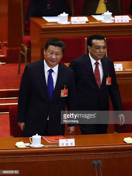 Xi Jinping China's president left and Li Keqiang China's premier arrive for the closing session of the third session of the 12th National People's...