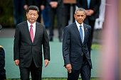 Xi Jinping China's president left and US President Barack Obama review troops during a ceremony on the South Lawn of the White House in Washington DC...