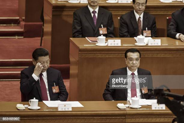 Xi Jinping China's president left glances over to Li Keqiang China's premier during the closing ceremony of the National People's Congress in Beijing...