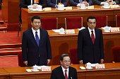 Xi Jinping China's president left Li Keqiang China's premier right and Yu Zhengsheng a member of China's Politburo Standing Committee front attend...