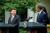 Xi Jinping China's president left listens during a joint news conference with US President Barack Obama in the Rose Garden at the White House in...