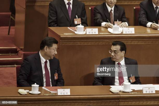 Xi Jinping China's president left speaks with Li Keqiang China's premier during the closing ceremony of the National People's Congress in Beijing...