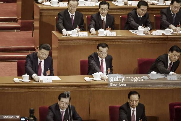 Xi Jinping China's president middle row left to right Li Keqiang China's premier and Liu Yunshan deputy general secretary of the Communist Party of...