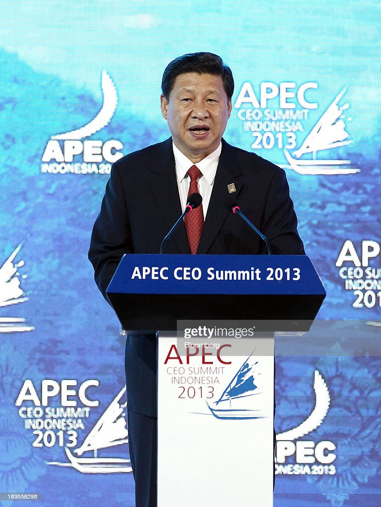 <a gi-track='captionPersonalityLinkClicked' href=/galleries/search?phrase=Xi+Jinping&family=editorial&specificpeople=2598986 ng-click='$event.stopPropagation()'>Xi Jinping</a>, China's president, speaks at the Asia-Pacific Economic Cooperation (APEC) CEO Summit in Nusa Dua, Bali, Indonesia, on Monday, Oct. 7, 2013. Asia-Pacific governments are calling for vigilance against protectionism as economic growth slows in parts of the region and completion of a 12-nation trade accord looks set to be delayed further. Photographer: SeongJoon Cho/Bloomberg via Getty Images