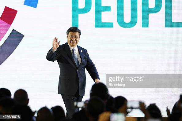 Xi Jinping China's president waves as he arrives on stage at the AsiaPacific Economic Cooperation CEO Summit in Manila the Philippines on Wednesday...